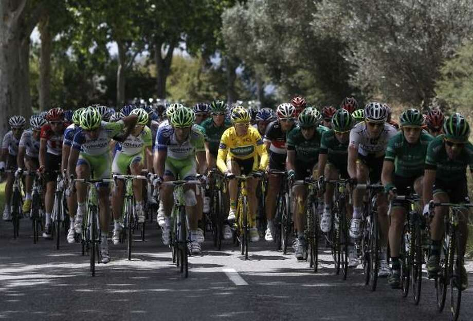 A ray of sunlight hits overall leader Thomas Voeckler of France as he rides in the pack during the 15th stage. Photo: Laurent Cipriani, Associated Press