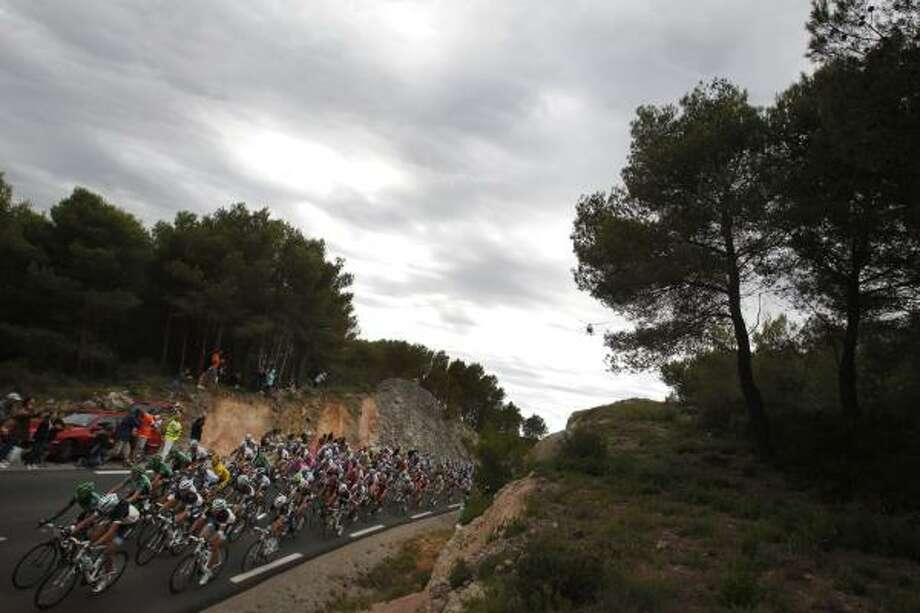 The pack passes during the 15th stage of the Tour de France cycling race over 193 kilometers (120 miles) starting in Limoux and finishing in Montpellier. Photo: Christophe Ena, Associated Press