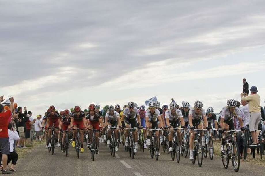 The pack rides during the 15th stage of the Tour de France. Photo: Laurent Cipriani, Associated Press
