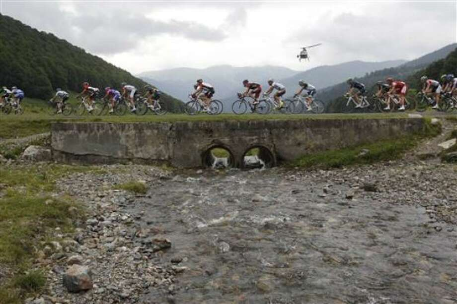 Stage winner Samuel Sanchez of Spain climbs towards Luz Ardiden during the 12th stage. Photo: Christophe Ena, AP