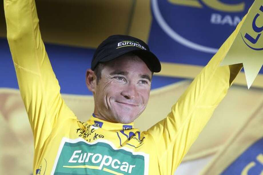 July 13Eleventh StageThomas Voeckler of France, wearing the overall leader's yellow jersey, celebrates on the podium of the 11th stage. Photo: Laurent Cipriani, Associated Press