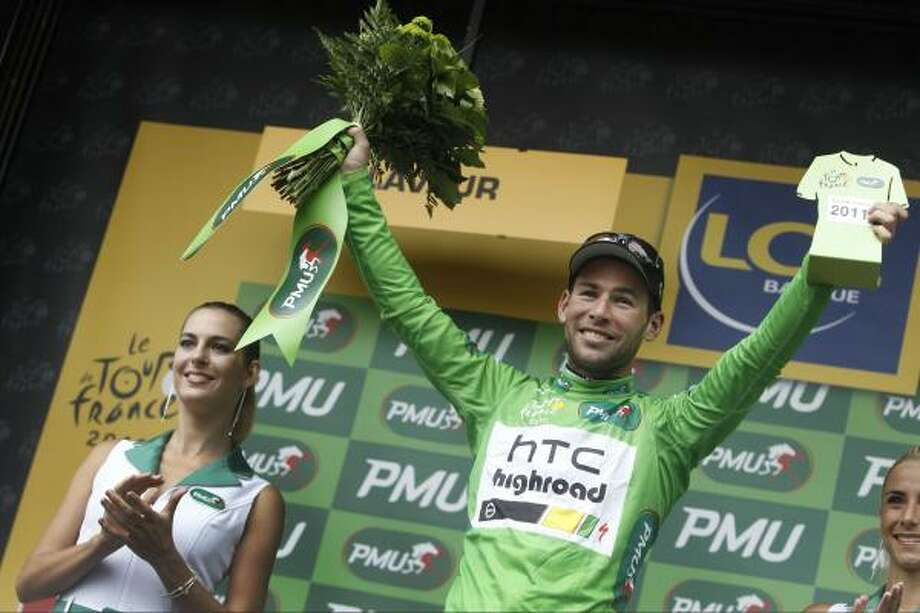 Stage winner Mark Cavendish of Britain, wearing the best sprinter's green jersey, celebrates on the podium of the 11th stage. Photo: Laurent Cipriani, Associated Press
