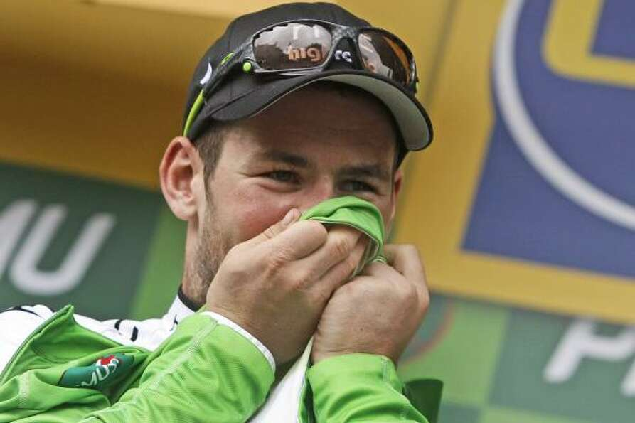 Stage winner Mark Cavendish of Britain kisses the best sprinter's green jersey on the podium of the