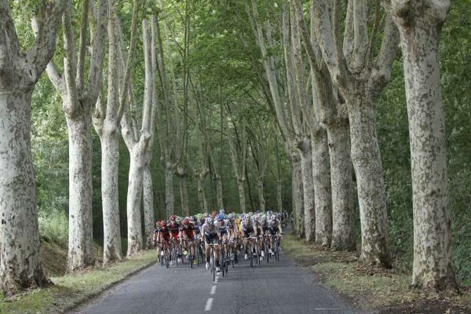 The pack rides during the 11th stage of the Tour de France. Photo: Laurent Cipriani, Associated Press