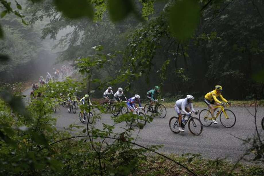 Thomas Voeckler of France, wearing the overall leader's yellow jersey, rides in the pack during the 11th stage of the Tour de France. Photo: Christophe Ena, Associated Press