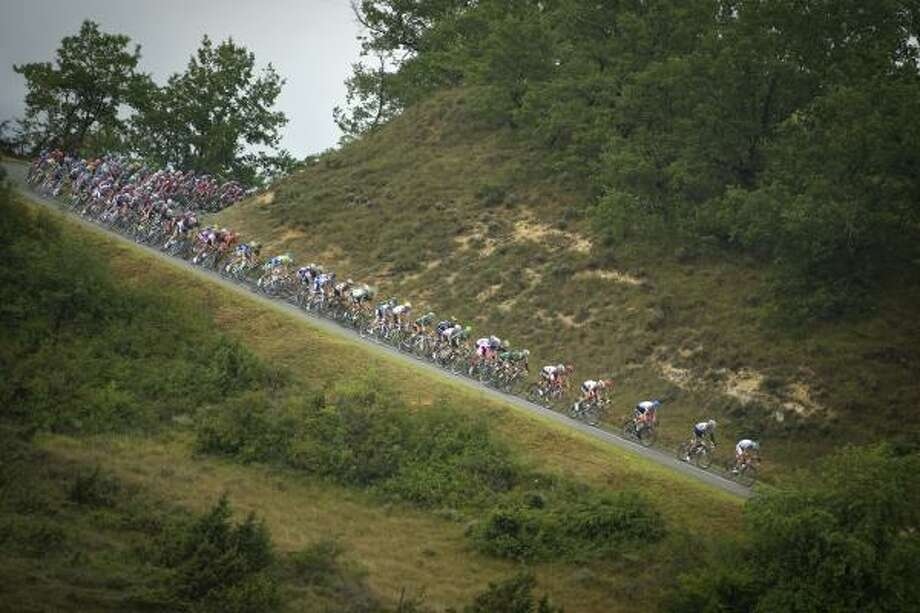 The pack ride in the eleventh stage of the 2011 Tour de France between Blaye-les-Mines and Lavaur. Photo: LIONEL BONAVENTURE, Getty