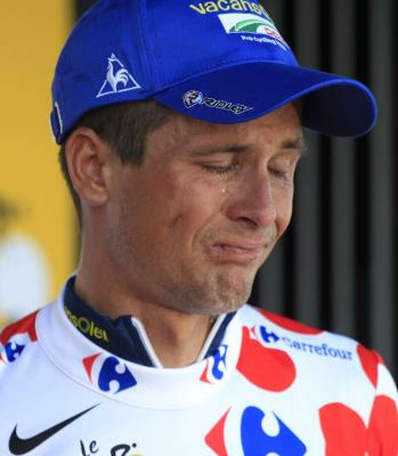 Johnny Hoogerland of The Netherlands, wearing the best climber's dotted jersey, cries on the podium of the ninth stage. Photo: Laurent Rebours, Associated Press