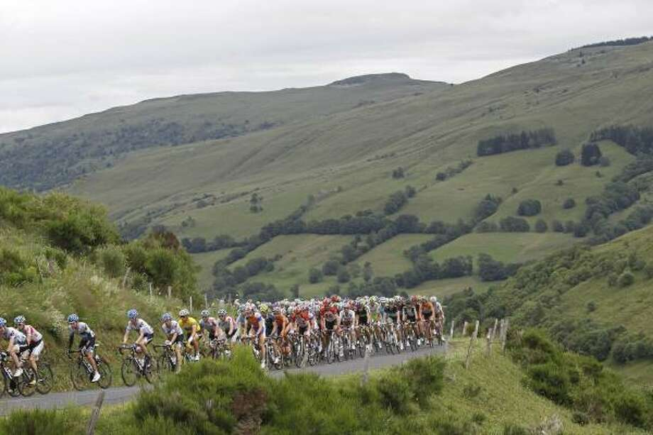 The pack climbs towards Massiac Pass during the ninth stage. Photo: Laurent Cipriani, Associated Press