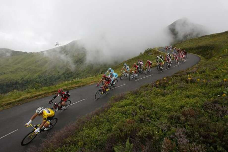 The pack with Thor Hushovd of Norway, wearing the overall leader's yellow jersey, speeds down Massiac pass during the ninth stage of the Tour de France. Photo: Christophe Ena, Associated Press