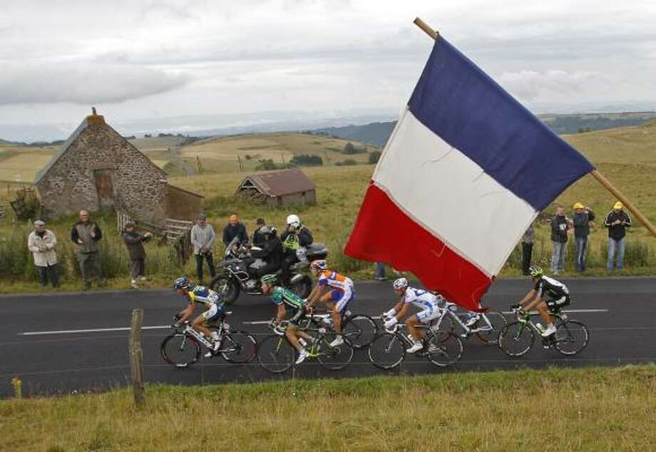 The breakaway group with Johnny Hoogerland of The Netherlands, Thomas Voeckler of France, Luis-Leon Sanchez of Spain, Sandy Casar of France, and Juan Antonio Flecha of Spain, from front to rear, climbs towards  Massiac Pass during the ninth stage. Photo: Christophe Ena, Associated Press