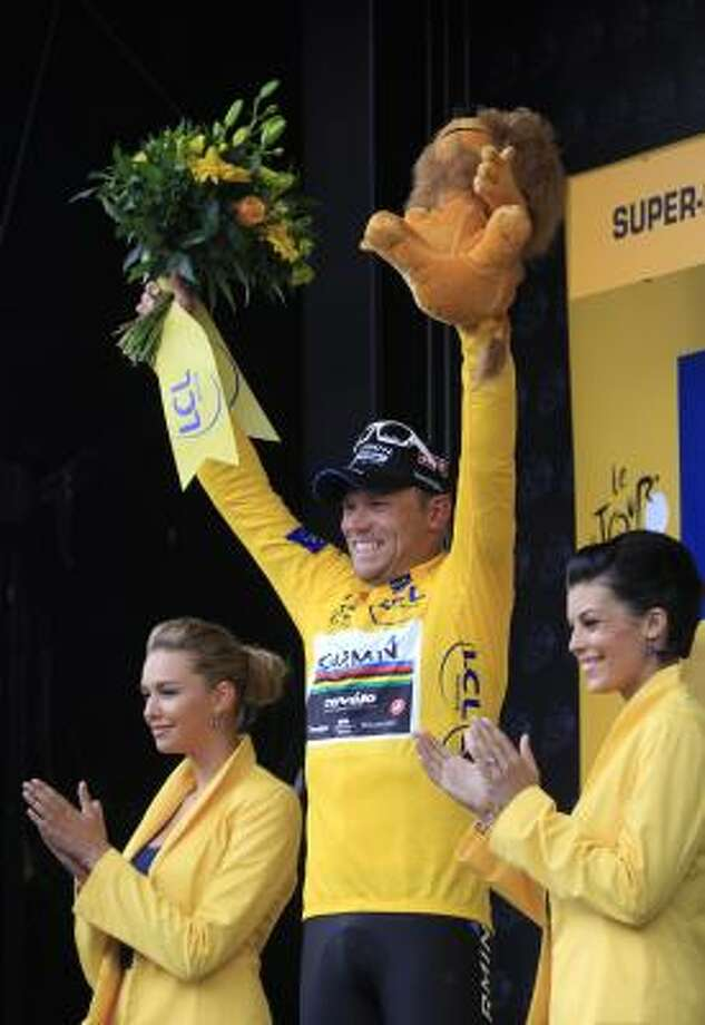 July 9Eighth StageThor Hushovd of Norway, wearing the overall leader's yellow jersey, celebrates on the podium of the 8th stage of the Tour de France. Photo: Laurent Rebours, Associated Press