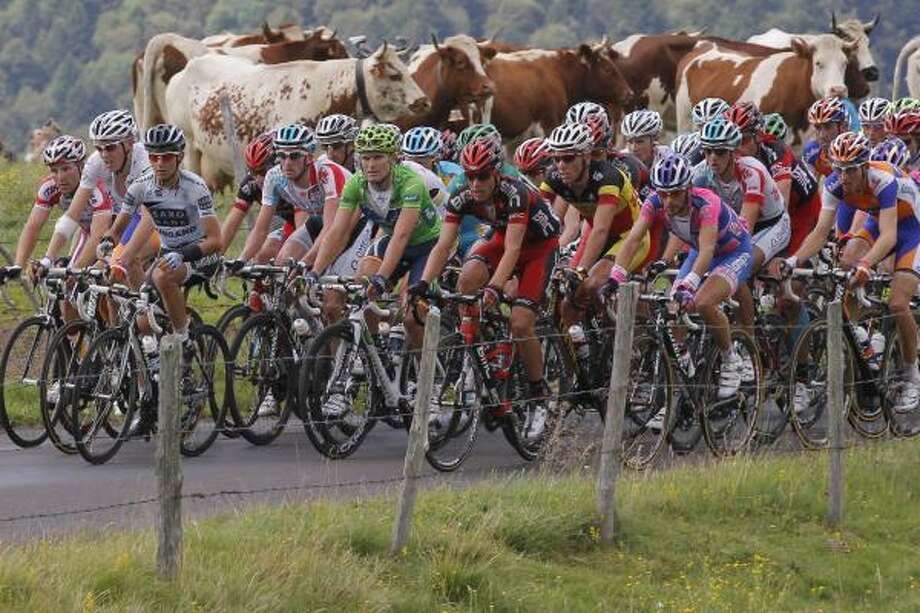 The pack climbs La Croix Saint Robert Pass during the eighth stage. Photo: Christophe Ena, Associated Press
