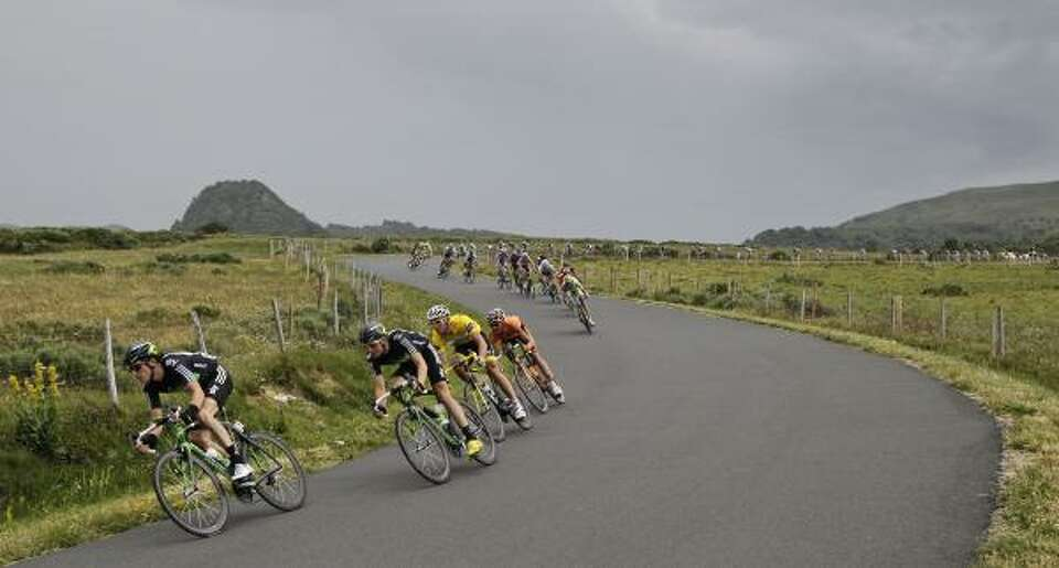 Geraint Thomas of Britain, left, Edvald Boasson Hagen of Norway, second left, lead before Thor Husho