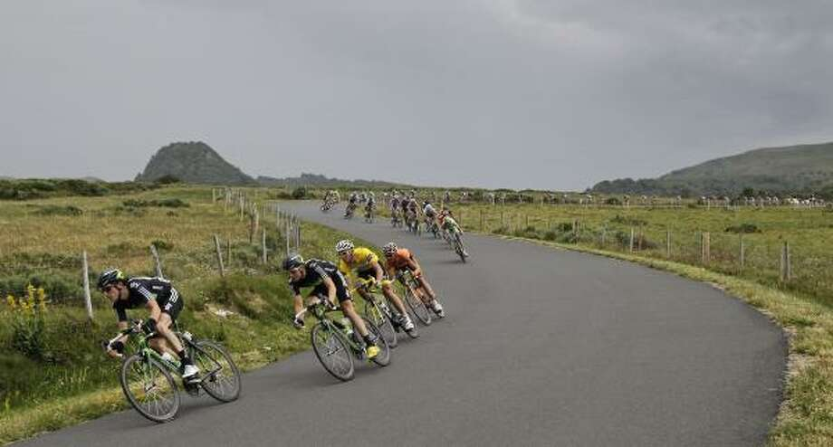 Geraint Thomas of Britain, left, Edvald Boasson Hagen of Norway, second left, lead before Thor Hushovd of Norway, wearing the overall leader's yellow jersey, as they speed down La Croix Saint Robert pass during the eighth stage of the Tour de France. Photo: Laurent Cipriani, Associated Press