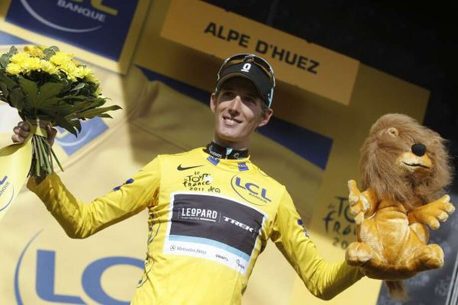 July 22    19th Stage  Andy Schleck of Luxembourg, wearing the overall leader's yellow jersey, clebrates on the podium of the 19th stage of the Tour de France. Photo: Laurent Cipriani, Associated Press