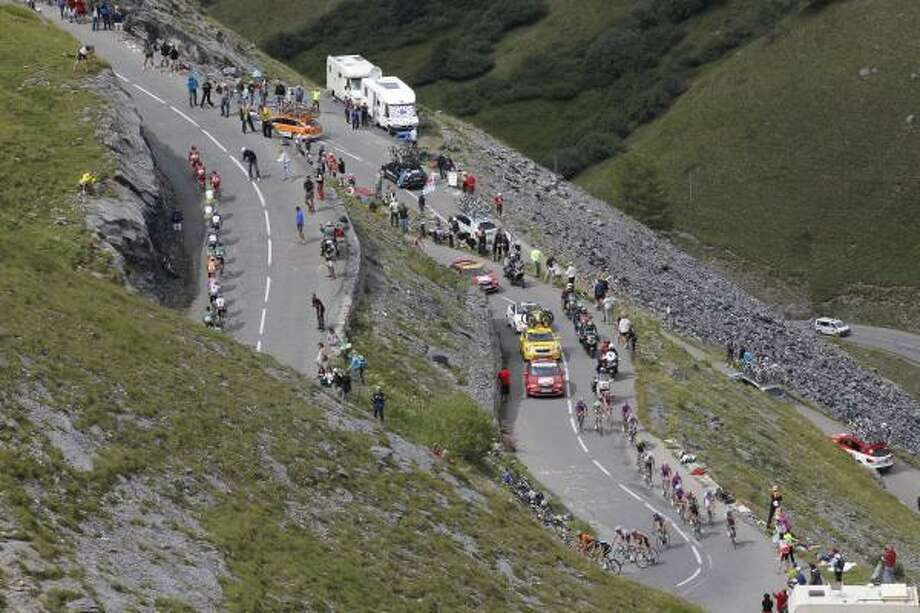 The pack climbs Galibier pass during the 19th stage of the Tour de France. Photo: Christophe Ena, Associated Press