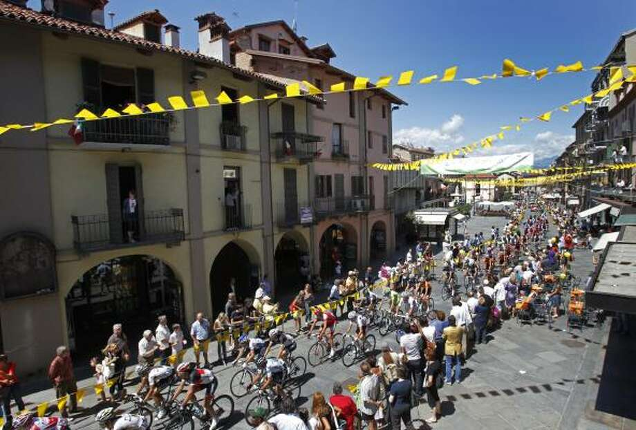 The pack passes Saluzzo during the 18th stage of the Tour de France. Photo: Christophe Ena, Associated Press