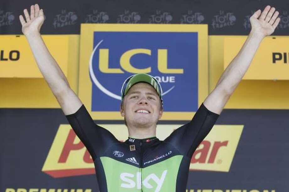 July 20    17th Stage  Stage winner Edvald Boasson Hagen of Norway celebrates on the podium of the the 17th stage. Photo: Laurent Cipriani, Associated Press