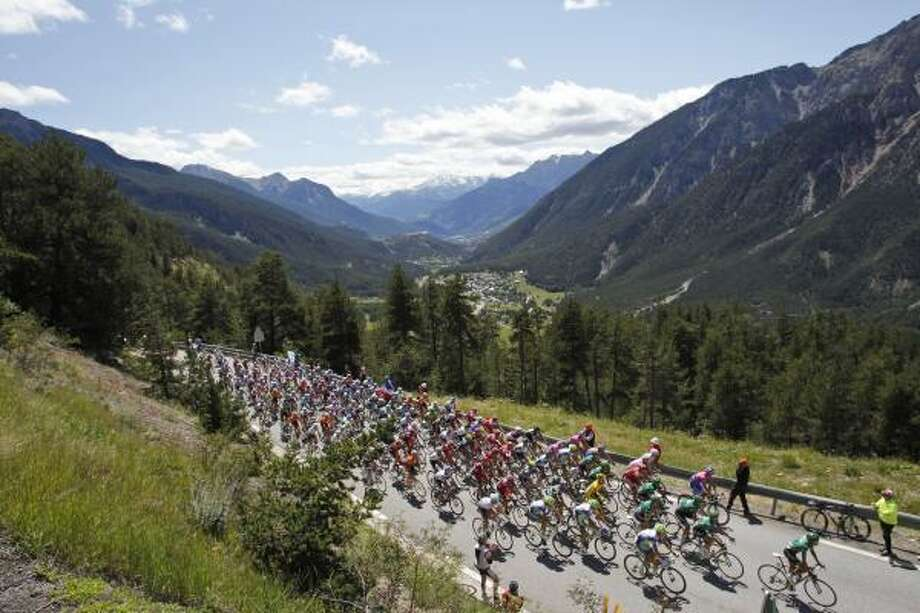 The pack climbs towards Montgenevre, France, during the 17th stage of the Tour de France. Photo: Christophe Ena, Associated Press