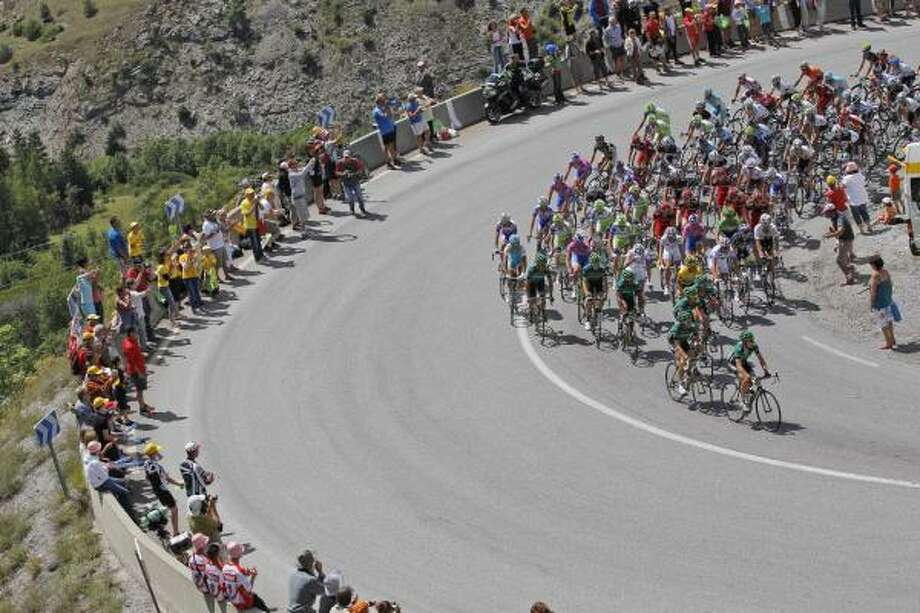 The pack climbs Saint Marguerite mountain during the 17th stage. Photo: Christophe Ena, Associated Press