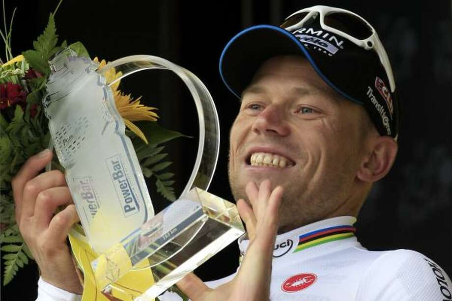 Stage winner Thor Hushovd of Norway, holds the trophy on the podium of the 16th stage. The race started in Saint Paul Trois Chateaux and finished in Gap, southern France. Photo: Laurent Rebours, Associated Press