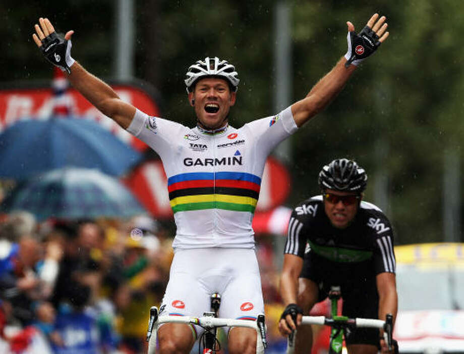 Thor Hushovd of Norway and Team Garmin-Cervelo celebrates as compatriot Edvald Boasson-Hagen of SKY Procycling finishes 2nd. Photo: Bryn Lennon, Getty