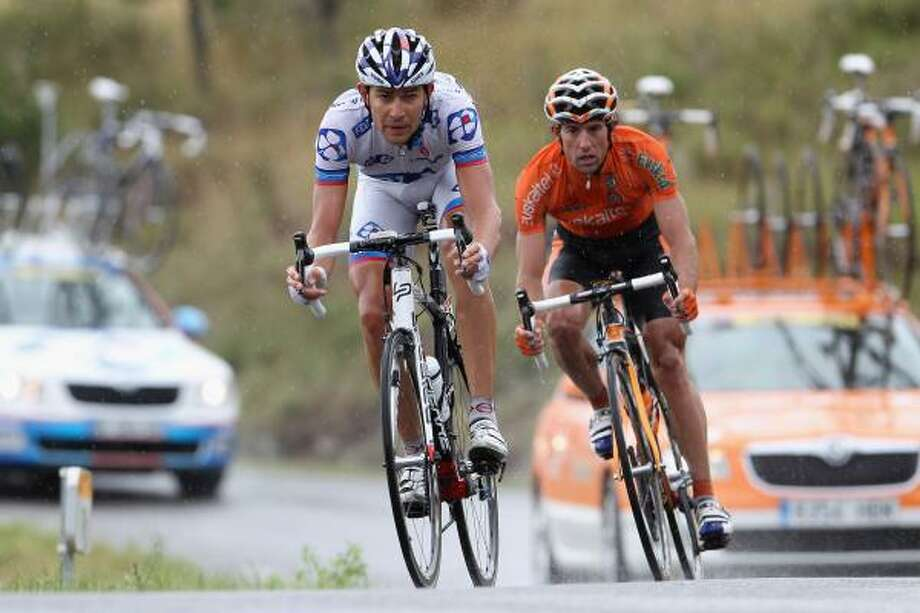 Jeremy Roy (L) of  France and team FDJ is tracked by Alan Perez Lezaun (R) of Spain and team Euskaltel-Euskadi as they descend from Col du Mense. Photo: Michael Steele, Getty