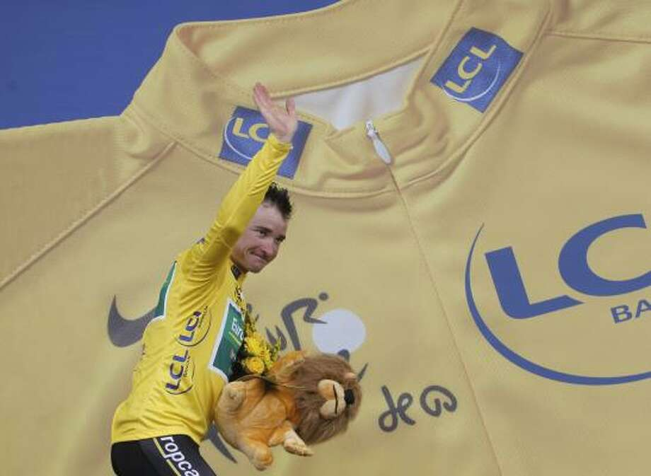 July 17    15th Stage  Thomas Voeckler of France, wearing the overall leader's yellow jersey, waves to fans on the podium of the 15th stage of the Tour de France. Photo: Laurent Cipriani, Associated Press