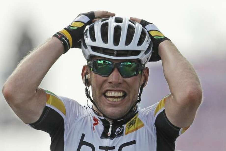 Mark Cavendish of Britain celebrates as he crosses the finish line to win the seventh stage. Photo: Laurent Cipriani, Associated Press