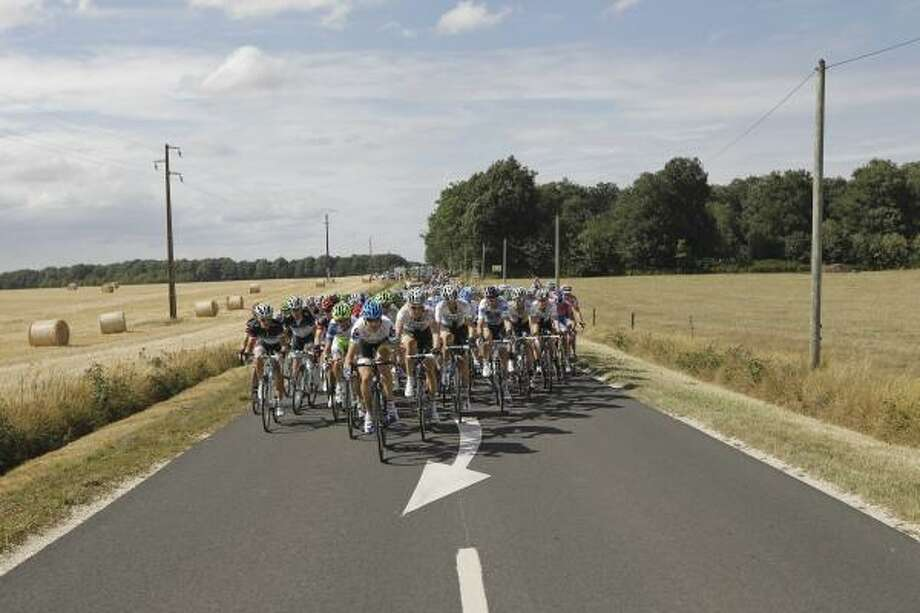 The pack rides during the seventh stage of the Tour de France cycling race over 218 kilometers (135.5 miles) starting in Le Mans and finishing in Chateauroux. Photo: Laurent Cipriani, Associated Press