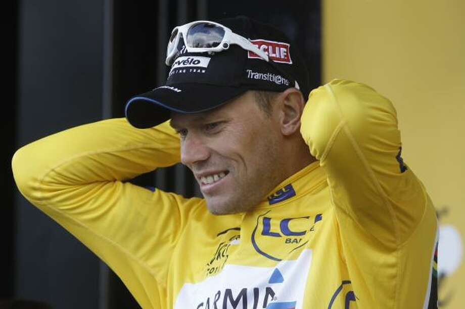 Thor Hushovd of Norway adjusts the overall leader's yellow jersey on the podium of the sixth stage. Photo: Laurent Cipriani, Associated Press