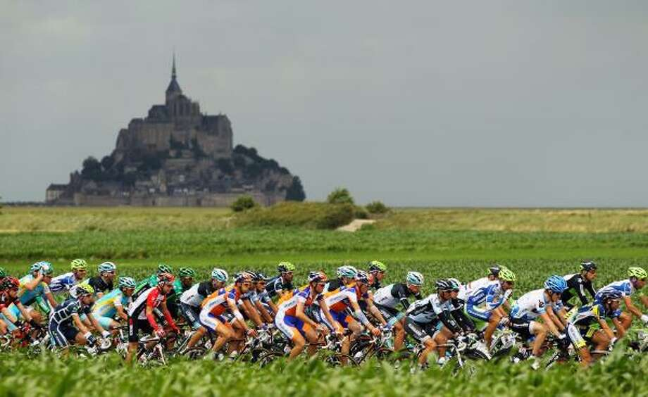 The peloton passes by Le Mont-Saint-Michel at the start of stage six of the 2011 Tour de France. Photo: Bryn Lennon, Getty