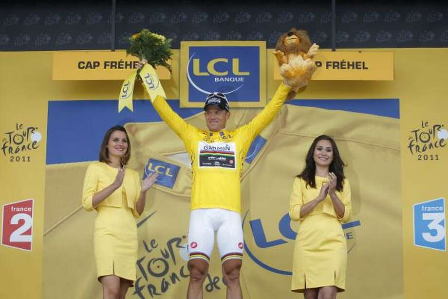 July 6Fifth StageThor Hushovd of Norway, wearing the overall leader's yellow jersey, celebrates on the podium of the fifth stage of the Tour de France. Photo: Christophe Ena, Associated Press