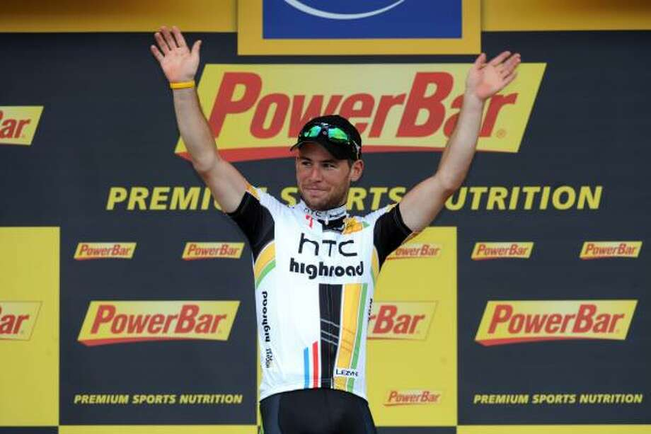 Britain's Mark Cavendish celebrates on the podium after winning the fifth stage. Photo: PASCAL PAVANI, Getty