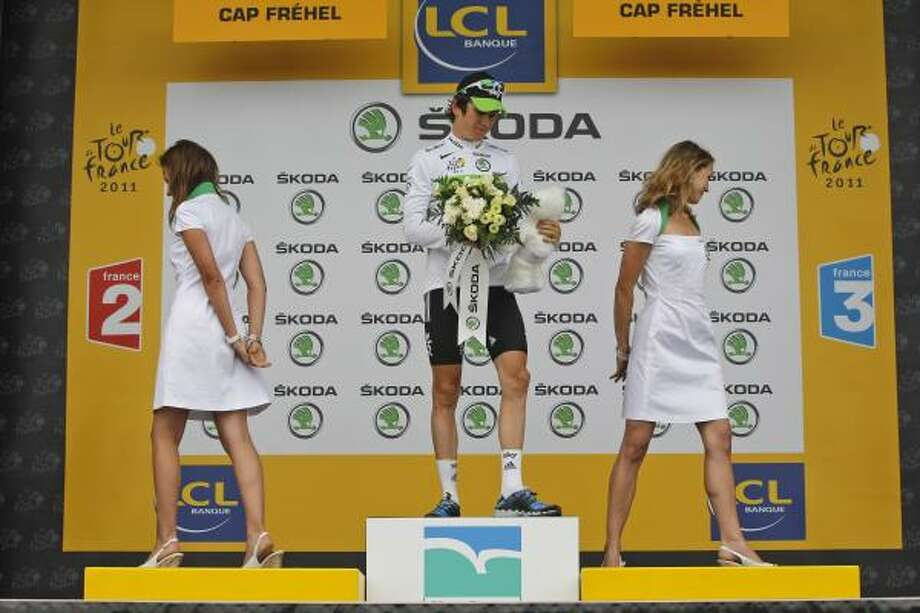 Geraint Thomas of Britain, wearing the best young rider's white jersey, leaves the podium of the fifth stage of the Tour de France cycling race over 164.5 kilometers. Photo: Christophe Ena, Associated Press