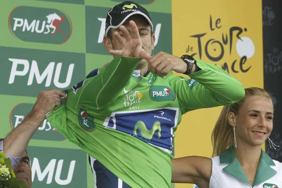 Jose Joaquin Rojas of Spain, adjusts the  best sprinter's green jersey after completing the fifth stage. Photo: Laurent Cipriani, Associated Press