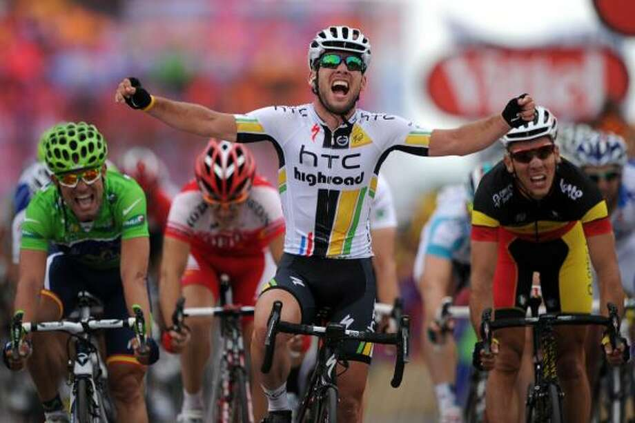 Stage winner, Britain's Mark Cavendish (C) celebrates on the finish line as he wins ahead of second-placed and new Green jersey of best sprinter, Belgium's Philippe Gilbert (R), and third-placed Jose Joaquim Rojas (L). Photo: PASCAL PAVANI, Getty