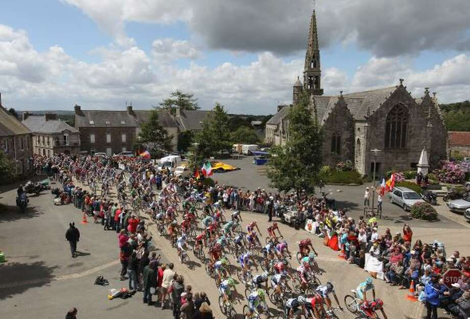 The peloton passes through La Chapelle Neuve during the fifth stage of the 2011 Tour de France. Photo: Michael Steele, Getty