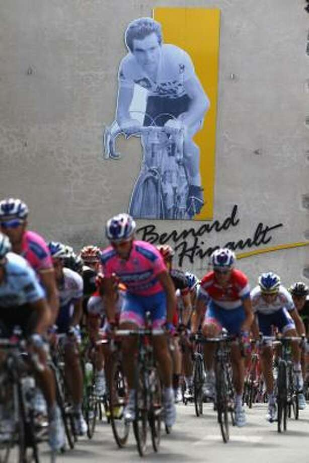 The peloton passes through Yffiniac, the home town of racing legend Bernard Hinault. Photo: Michael Steele, Getty