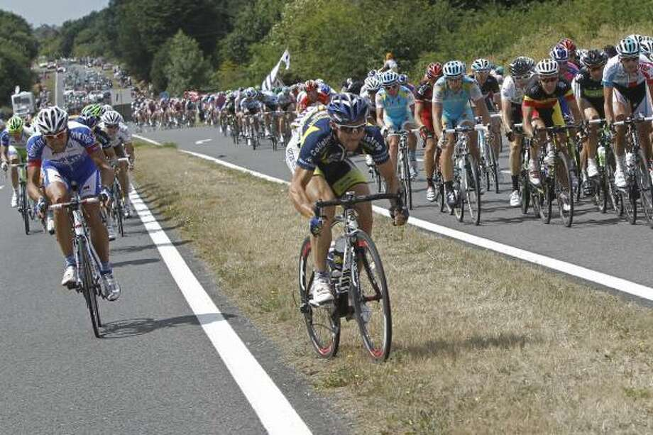 Romain Feillu of France, center, crosses over from one part of the pack  to another, after the pack got split up on a roundabout. Photo: Laurent Cipriani, Associated Press