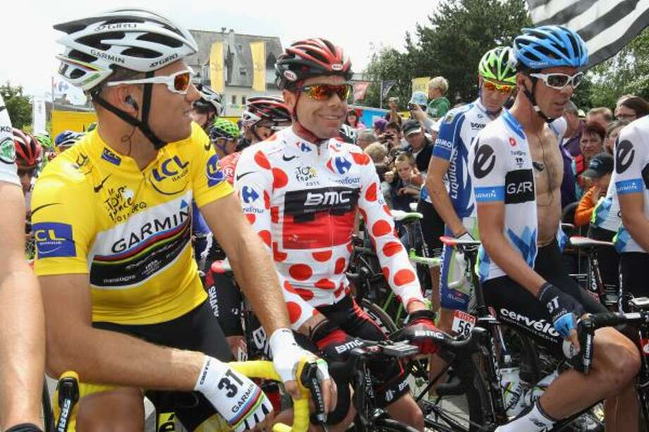 Thor Hushovd (L) of Norway and holder of the yellow jersey alongside King of the Mountains jersey, Cadel Evans (C) of Australia and David Millar (R) of Great Britain and team Garmin Cervelo line up at the start of the fifth stage. Photo: Michael Steele, Getty