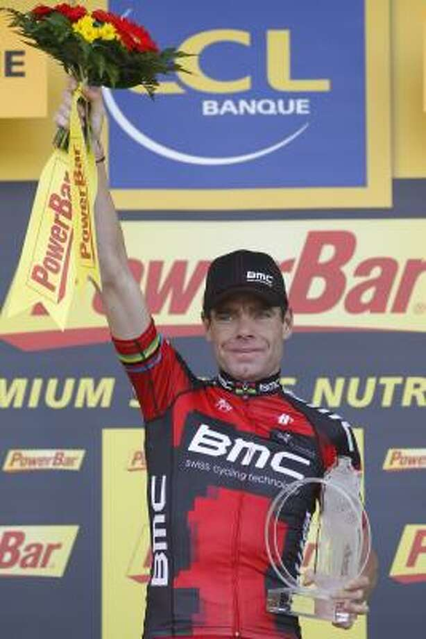 July 5Fourth StageStage winner Cadel Evans of Australia celebrates on the podium of the fourth stage of the Tour de France. Photo: Christophe Ena, Associated Press