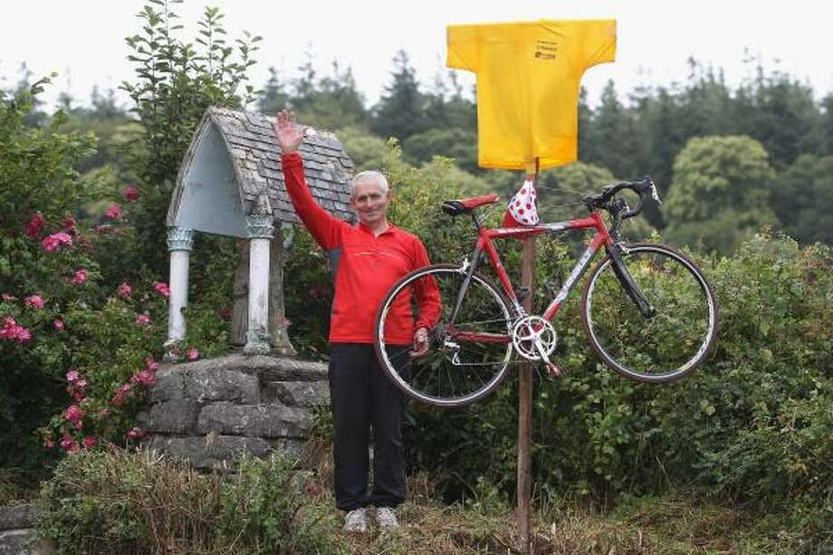 A cycling enthusiast poses with his decorated bike during the fourth stage. Photo: Michael Steele, Getty