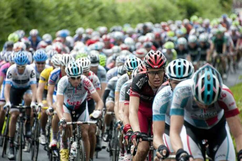 The pack rides through western France in the fourth stage. Photo: LIONEL BONAVENTURE, Getty