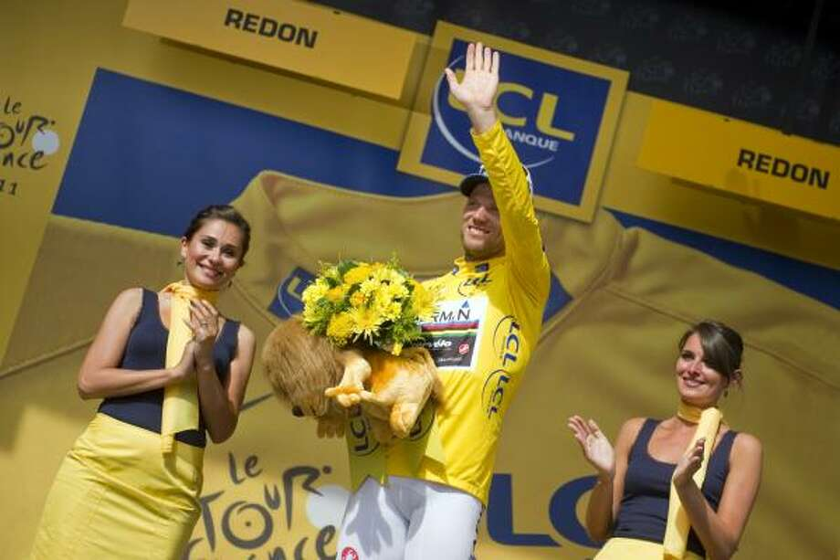 July 4Third StageNorway's Thor Hushovd, yellow jersey, and overall leader, waves on the podium at the end of the 198 km third stage of the 2011 Tour de France. Photo: LIONEL BONAVENTURE, Getty