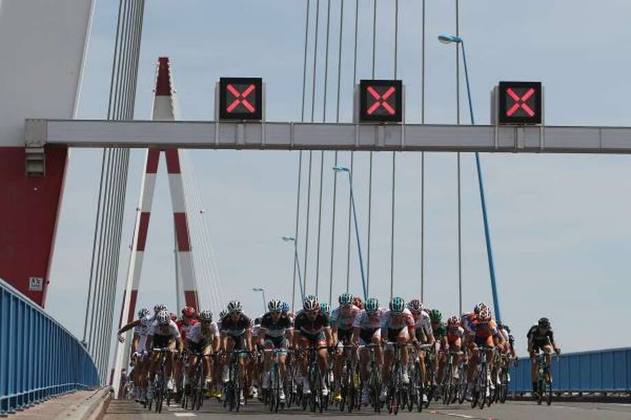The peloton makes its way over a bridge towards St Nazaire during the third stage. Photo: Michael Steele, Getty