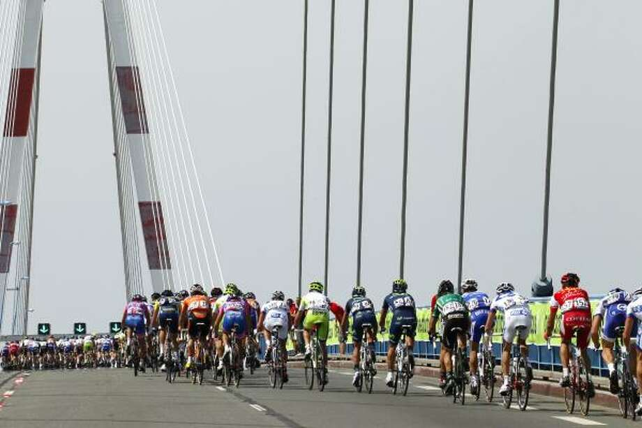The pack rides on the Saint-Nazaire bridge during the 198 km. third stage. Photo: JOEL SAGET, Getty