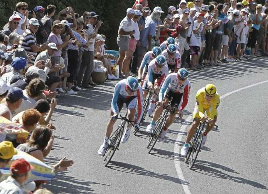 The Omega Pharma-Lotto cycling team with Philippe Gilbert of Belgium, wearing the overall leader's yellow jersey, rides during the second stage of the Tour de France. Photo: Laurent Cipriani, Associated Press