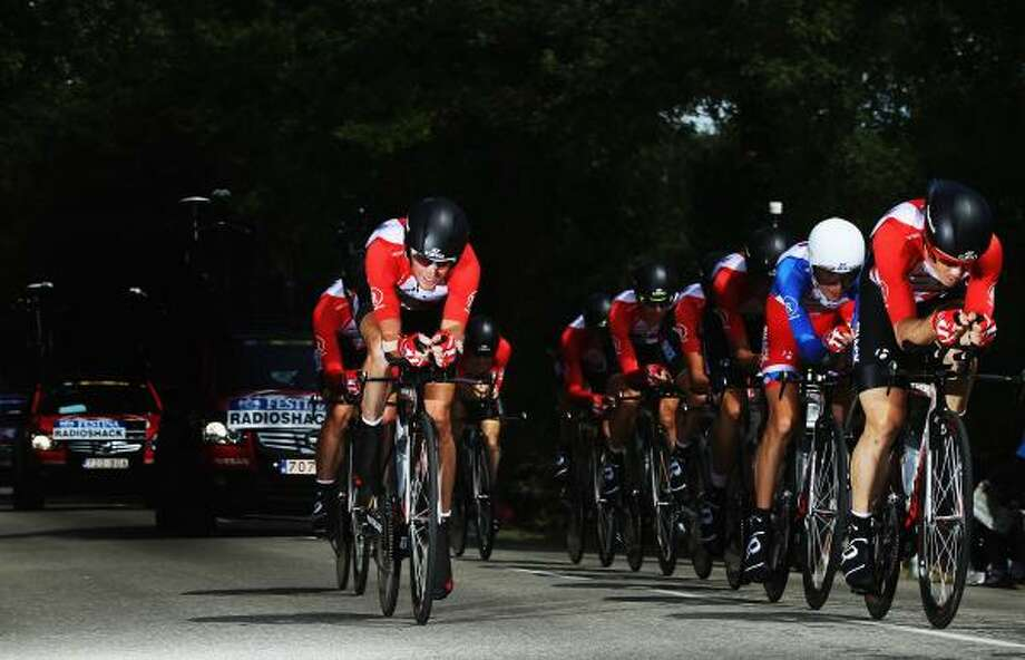 The Radioshack team are seen in action during the stage two team time trial of the 2011 Tour de France. Photo: Bryn Lennon, Getty