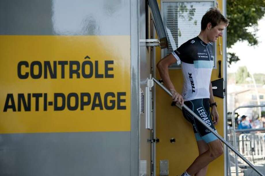 Luxembourg's Andy Schleck leaves the anti-doping control bus at the end of the 23 km team time-trial. Photo: NATHALIE MAGNIEZ, Getty